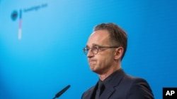 FILE-In this Sept. 2, 2020 file photo German Foreign Minister Heiko Maas attends a press conference at the Foreign Ministry in Berlin, Germany. Germany is increasing pressure on Russia over the poisoning of Russian opposition politician Alexei…