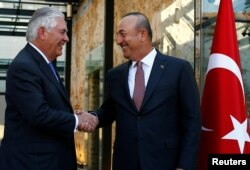 U.S. Secretary of State Rex Tillerson, left, meets with Turkish Foreign Minister Mevlut Cavusoglu in Istanbul, Turkey, July 9, 2017.