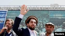 FILE - Ahmad Massoud, son of Afghanistan's slain anti-Soviet resistance hero Ahmad Shah Massoud, waves as he arrives to attend a gathering in Bazarak, Panjshir province, Afghanistan, Sept. 5, 2019.
