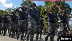 Yon kontijann PNH (Polis Nasyonal d Ayiti).