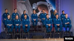 In this January 10, 2020 photo, the 2017 Class of Astronauts participate in graduation ceremonies at the Johnson Space Center in Houston, Texas.