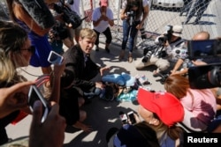 """Albuquerque mayor Tim Keller leaves a stuff animal outside of the children's tent encampment built to deal with the Trump administrations """"zero tolerance"""" policy in Tornillo, Texas, June 21, 2018."""