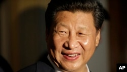 Chinese President Xi Jinping smiles as he concludes a visit to Lincoln High School, Wednesday, Sept. 23, 2015.
