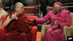 The Dalai Lama, left, sits with Archbishop Desmond Tutu, of South Africa, Tuesday, April 15, 2008 prior to speaking at the University of Washington in Seattle. (AP Photo/Ted S. Warren)