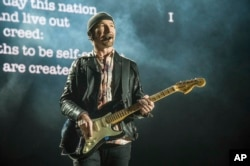 The Edge of U2 performs at the Bonnaroo Music and Arts Festival, June 9, 2017, in Manchester, Tenn. The Edge, whose name is David Evans, received the Les Paul Spirit Award before the band's set.