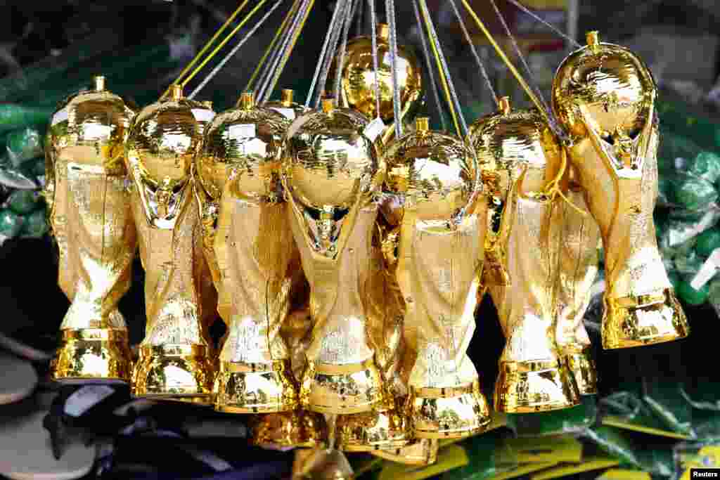 Souvenirs of the World Cup soccer trophy are put on sale in a shop in Ribeirao Preto, 336 km northwest of Sao Paulo, June 13, 2014.