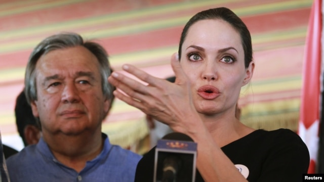 The U.N. refugee agency's special envoy, actress Angelina Jolie, speaks during a news conference with U.N. High Commissioner for Refugees (UNHCR) Antonio Guterres (L) at a refugee camp in Jordan, Sept 11, 2012.