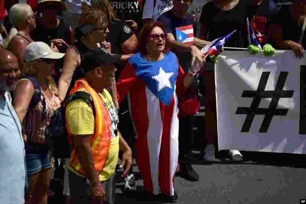 Thousands of Puerto Ricans gather for what was expected to be one of the biggest protests ever seen in the U.S. territory, with irate islanders pledging to drive Gov. Ricardo Rossello from office, in San Juan, Puerto Rico.
