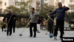 "Retirees practice ""Cola Ball"" with music, an invented community activity in central Beijing, Oct. 17, 2013. China is close to announcing long-awaited reforms to its pension system, whose assets are estimated to have already fallen $3 trillion behind projected future payouts."