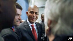 Haiti's President-elect Michel Martelly greets supporters after holding a news conference at the National Press Club in Washington, Apr 21 2011