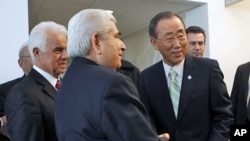 United Nations Secretary-General Ban Ki-moon (R) speaks with Greek Cypriot leader Dimitris Christofias (C) and his Turkish Cypriot counterpart Dervis Eroglu (L) following their meetings at United Nations headquarters in New York, January 25, 2012