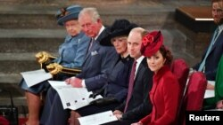FILE PHOTO: Britain's Queen Elizabeth II, Prince Charles, Camilla, Duchess of Cornwall, Prince Harry and Meghan, Duchess of Sussex, and Prince William and Catherine, Duchess of Cambridge attend the annual Commonwealth Service at Westminster Abbey in Londo