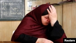 Maria, the mother of 18-year-old Ismael who was arrested in Piera on suspicion of having links to Islamist militant activities, weeps at their home in Piera, northeastern Spain, March 13, 2015.