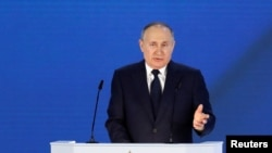 Russian President Vladimir Putin gestures as he delivers his annual address to the Federal Assembly in Moscow, Russia April 21, 2021.