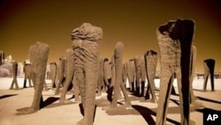 Agora, a procession of 106 headless and armless cast-iron sculptures at the south end of Grant Park in Chicago, was designed by Polish artist Magdalena Abakanowicz.