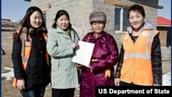 Baigalimaa Enebish, second from left, and members of her cooperative receive land titles through the MCC's Property Rights project in Mongolia. (Courtesy MCC)