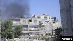 ຄວັນອອກມາຈາກ ຊານເມືອງ Erbeen ໃນນະຄອນຫລວງ Damascus ຂອງຊີເຣຍ, 19 ກໍລະກົດ, 2012.