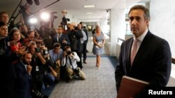 Michael Cohen, personal attorney for U.S. President Donald Trump, talks to reporters after meeting with Senate Intelligence Committee staff as the panel investigates alleged Russian interference in the 2016 U.S. presidential election, on Capitol Hill in W