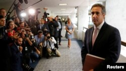 FILE - Michael Cohen, personal attorney for U.S. President Donald Trump, talks to reporters after meeting with Senate Intelligence Committee staff in Washington, Sept. 19, 2017.