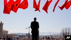 Kosovo president Hashim Thaci addresses the crowd gathered during the 20th anniversary of the NATO bombing in the village of Glogjan, Kosovo on March 24, 2019.