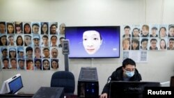 Software engineers work on a facial recognition system that identifies people when they wear a face mask at the development lab of the Chinese electronics manufacturer Hanwang (Hanvon) Technology in Beijing as the country is hit by an outbreak of the nove