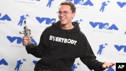 "Logic poses in the press room with the award for best fight against the system for ""Black SpiderMan"" at the MTV Video Music Awards at The Forum on Aug. 27, 2017, in Inglewood, Calif."