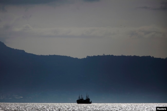 FILE - Chinese fishing trawlers anchor off the coast of Freetown, Sierra Leone, Nov. 18, 2012.