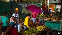 FILE - People shop at the El Egido food market in Havana, Cuba, Dec. 4, 2015.