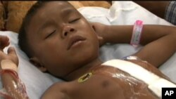Eight-year-old Nan Kini remains in the hospital, after his heart was repaired recently at a hospital in Siem Reap.
