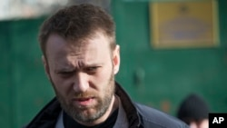 FILE - Russian opposition activist Alexei Navalny leaves a detention center in Moscow, Russia, Friday, March 6, 2015.
