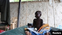 FILE - A South Sudanese child suffering from cholera sits on a bed in Juba Teaching Hospital.