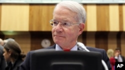 Joseph E. Macmanus, Permanent U.S. Representative to the United Nations, waits for the start of the IAEA board of governors meeting at the International Center in Vienna, Austria, March 6, 2013.