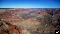 FILE - In this Oct. 5, 2013, file photo, the Grand Canyon National Park is covered in the morning sunlight as seen from a helicopter near Tusayan, Arizona.