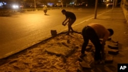 Morsi supporters remove part of a street to block a highway that links to the airport, Cairo, July 12, 2013.