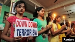 FILE - Students in Agartala, India, show solidarity with victims of a terrorist attack on a Bangladeshi café in early July. On Tuesday, Indian and U.S. officials announced plans for greater cooperation in combatting terrorism.
