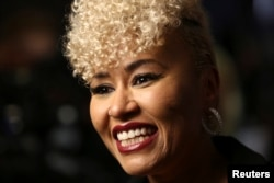 Emeli Sande smiles after receiving her award for British female solo artist at the Brit Awards at the O2 Arena in London, Feb. 22, 2017.