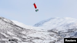 FILE - Qi Guangpu of China competes in the men's aerials race at the FIS Freestyle World Ski Championships in Voss, Norway, March 7, 2013.