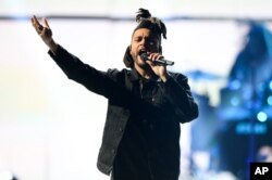 The Weeknd performs at Day 2 of the 2015 iHeartRadio Music Festival at the MGM Grand Garden Arena, Sept. 19, 2015, in Las Vegas, Nevada.