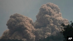 Mount Rokatenda is seen spewing volcanic material on Palue island, Indonesia, August 11, 2013.