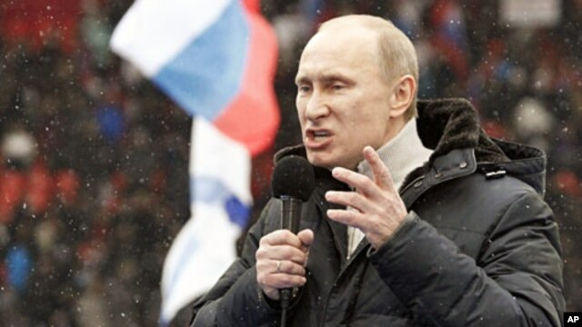 Presidential candidate and Russia's current Prime Minister Vladimir Putin delivers a speech during a rally in Moscow to support his candidature in the upcoming presidential election, February 23, 2012