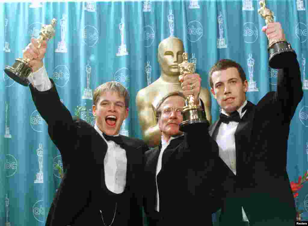 "Oscar winners (left to right) Matt Damon, Robin Williams and Ben Affleck hold their Oscars for their work on the film ""Good Will Hunting"" at the 70th Annual Academy Awards, March 23, 1998, in Los Angeles. Damon and Affleck won for Best Screenplay Written Directly for the Screen and Williams won for Best Supporting Actor."
