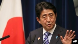 Japanese Prime Minister Shinzo Abe speaks during a press conference at his official residence after summit meetings with 10 Southeast Asian countries, in Tokyo, Dec. 14, 2013.