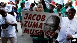 Demonstrators protest against South African President Jacob Zuma in Pretoria, April 4, 2017.