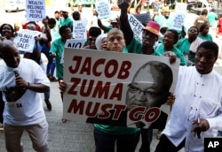 FILE - Demonstrators protest against South African President Jacob Zuma in Pretoria, South Africa, April 4, 2017.