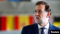 FILE - Spain's Prime Minister Mariano Rajoy speaks to media in Amari air base, Estonia, July 17, 2017.