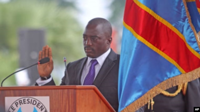 Congo President Joseph Kabila, center left, stands during his swearing-in ceremony for another term, in Kinshasa, Dec. 20, 2011.