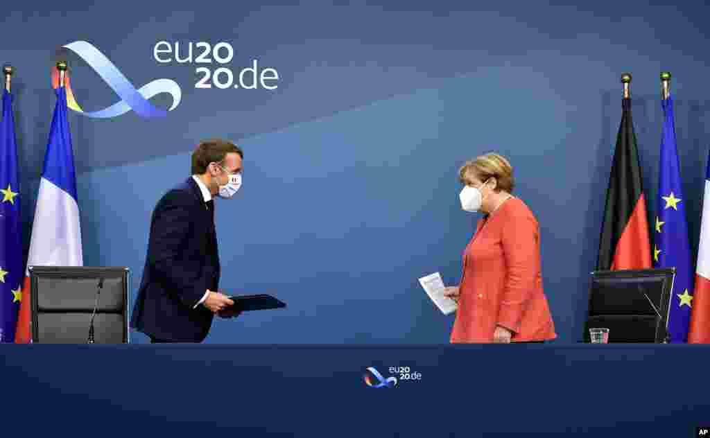 مرکل و مکرون رهبران آلمان و فرانسه. امروز بعد از چهار روز، رهبران اروپایی بر سر بودجه ۲.۱ هزار میلیارد دلاری و بسته کمک هزینه برای ترمیم اثرات شیوع ویروس کرونا توافق کردند.