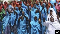 Thousands of Somalis rally in the Somali capital Mogadishu, August 23, 2011 at the Konis stadium as part of government organized demonstrations in support of the withdrawal of al- Shabab from Mogadishu.