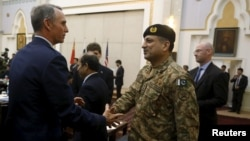 "FILE - A member of U.S. delegation (L) shakes hand with a member of Pakistani delegation before a meeting in Kabul, Afghanistan, January 18, 2016. Pakistani officials are particularly furious at a Congressional hearing last week in Washington under the title ""Pakistan: Friend or foe."""