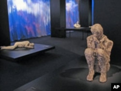 Plaster casts made from the fossilized imprints of Pompeiians who perished